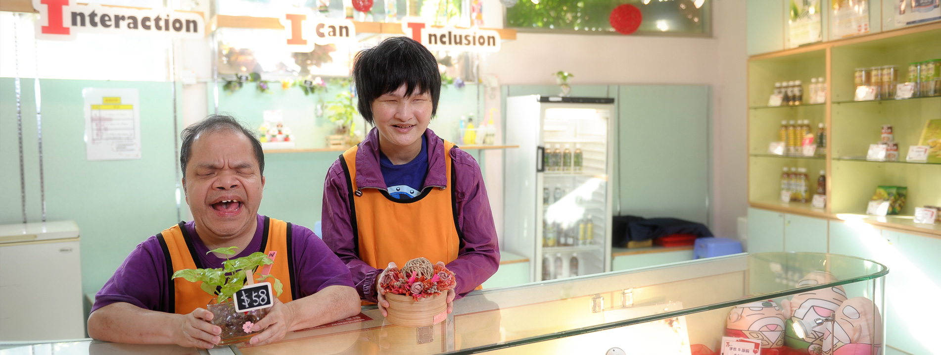 Two trainees with multiple disabilities at I-Shop